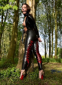 Kinky girl in latex outfit gets tied with ropes in an uncomfortable hogtied position