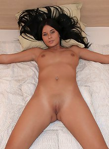 Mia gets naked in bed - fully spread
