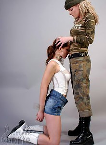 Camo dressed lady dominates her slave