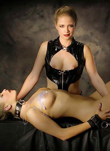 Dominatrix Angel Cassidy torments her slave Anna Mills