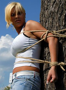 Farm girl tied to the tree