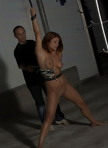 Redhead girl  is humiliated and whipped in the basement