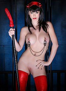 Devil brunette Emily Addison with dick on a stick