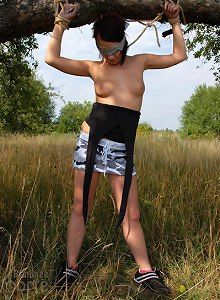 Brunette tied blindfolded, get her tit grabbed outdoor