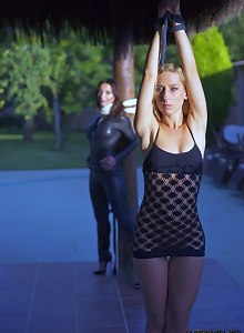 These two rope bound submissive girls are powerless in the hands of Cruel Master