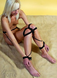 Blonde chick with long legs tied on a floor