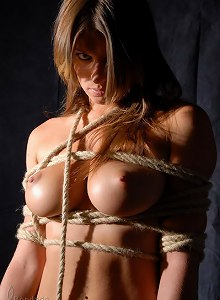 In this bdsm erotic session college girl tied up in shibari rope bondage