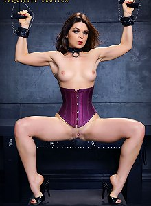 Hot brunette in corset tied up, gagged in dungeon