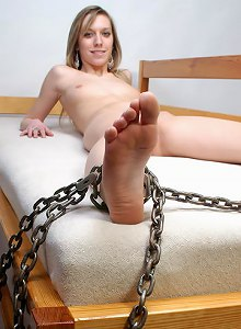 Hot babe chained on the bed