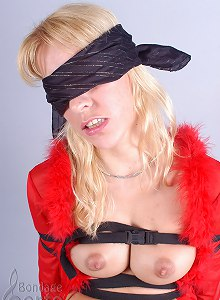 Horny chick tied by black strips and blindfolded