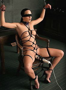 Rachel Luv tied up in rope harness, medical-gagged and vibrated