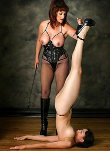 Submissive slave worships her domina